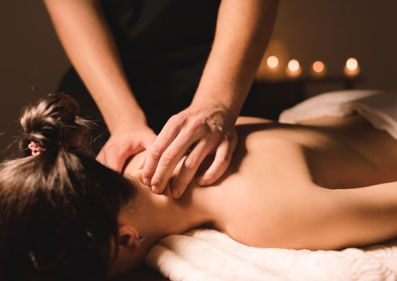 A lady receiving a full-body massage from a mobile massage therapist