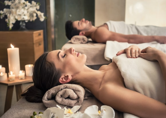 a beautiful couple receiving a relaxing mobile massage at home